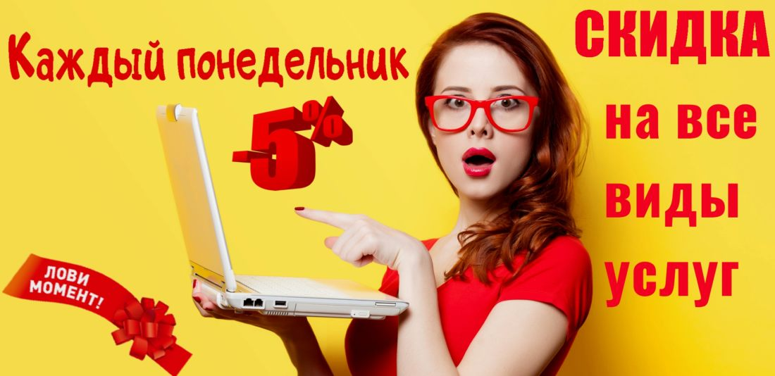 Surprised redhead girl with laptop on yellow background